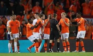 Netherlands' Donny van de Beek and teammates mither referee Clement Turpin about a goal scored by England's Jesse Lingard should go to a VAR review.