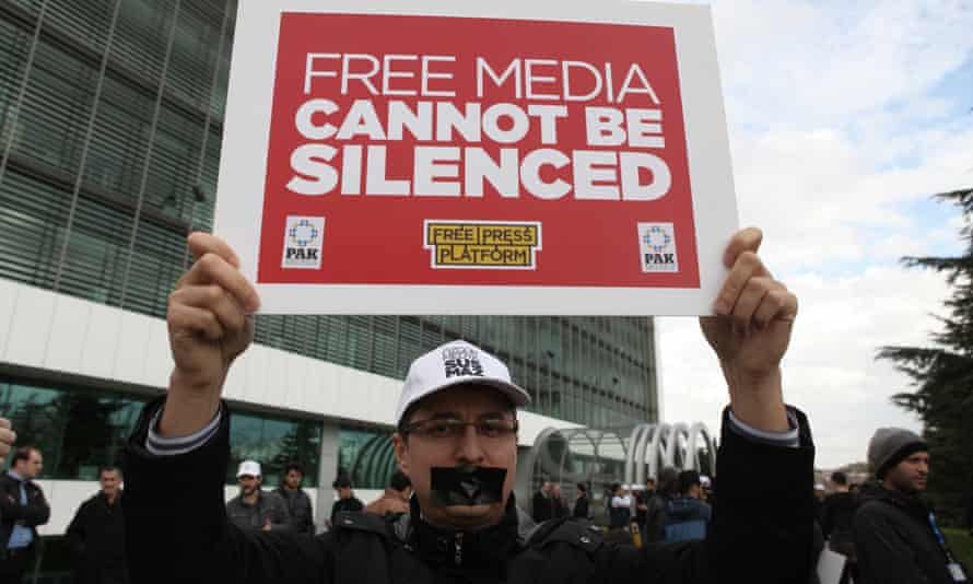 A man holds up a placard during a protest out the office of Zaman newspaper in Istanbul in March.