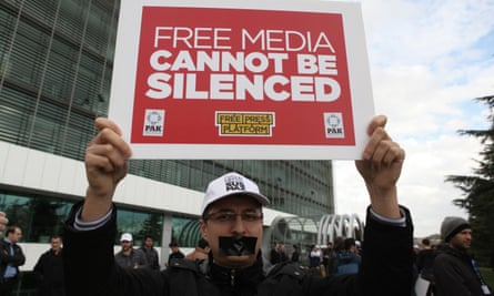 In the shadow of authoritarianism … protests outside the office of Zaman newspaper, Istanbul, over threats to press freedoms in Turkey. Photograph: Emrah Gurel/AP