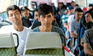 Refugees from Afghanistan in a federal police bus at the registration centre in Passau, Germany.