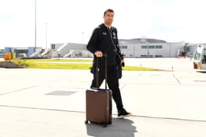 Sokratis boards the team flight at Luton airport on Saturday.