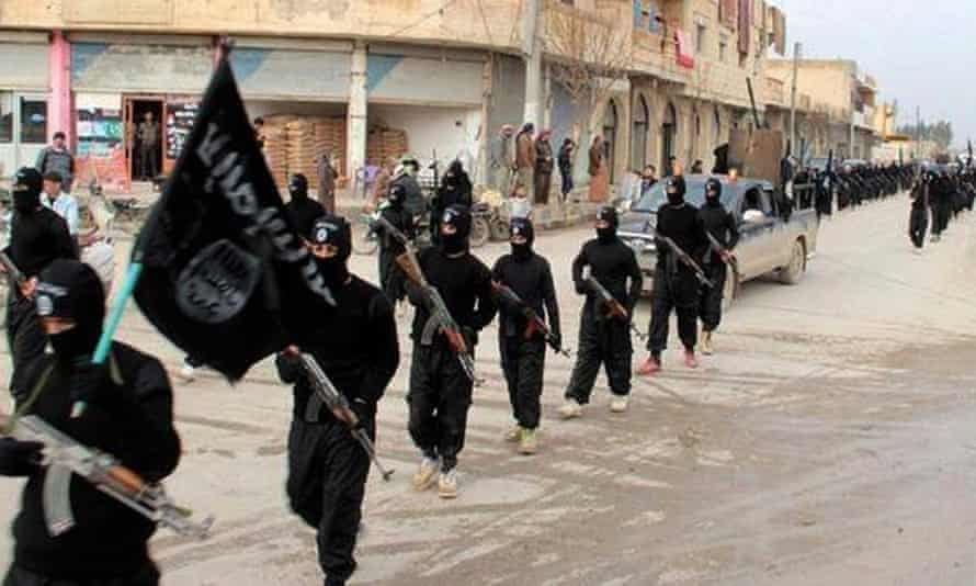 Isis fighters parading in Raqqa