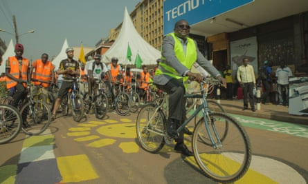A KCCA representative has his photo taken before the cyclists take off.
