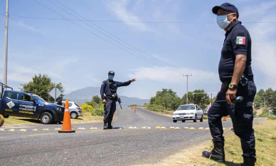 Community police members control vehicles in Michoacán state, Mexico on 11 April 2020. As authorities focus on pandemic control, analysts fear criminal groups will shift power from the state.