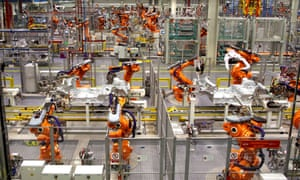 Robots ready to produce the new Mini Cooper at BMW's plant at Cowley in Oxford.