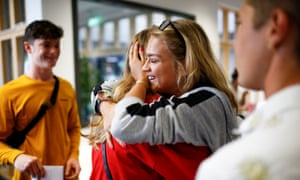 Sixth-form students receiving their A-level results at Stoke Newington school in London