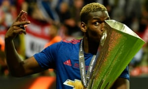 Manchester United's Paul Pogba celebrates with the trophy