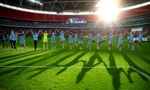 The Man City Ladies team celebrate winning the cup.