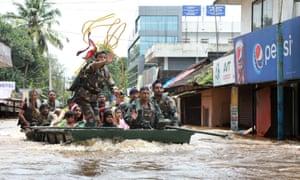 Soldiers evacuate local residents in Ernakulam.