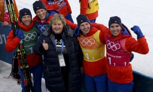 The prime minister, Erna Solberg, congratulates Norway's gold medallists in the men's 4x10km relay cross-country skiing in Pyeongchang.