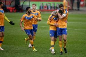 Mansfield Town's Stephen McLaughlin celebrates with team-mates.