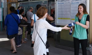 Rail passengers in Paris are given bottled water