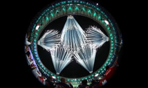 Fireworks explode to form the Olympic rings during the opening ceremony.