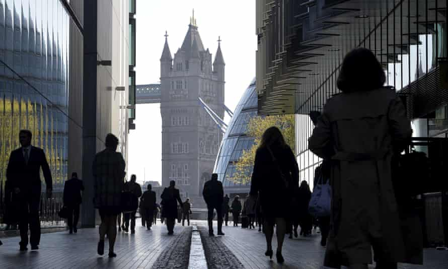 Office workers during the morning rush hour in Southwark in central London