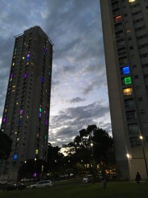 Waterloo public housing residents light up their windows.