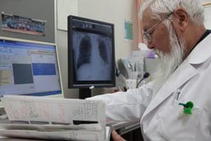 Dr Masaaki Shimanuki checks patient records in his office at Iwate Prefectural Takata hospital in Rikuzentakata.