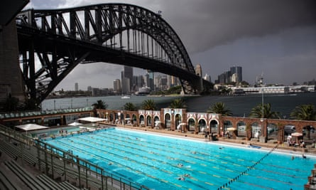 A blanket of dust is seen looming over North Sydney Olympic Pool and the Sydney Harbour Bridge on Thursday morning.
