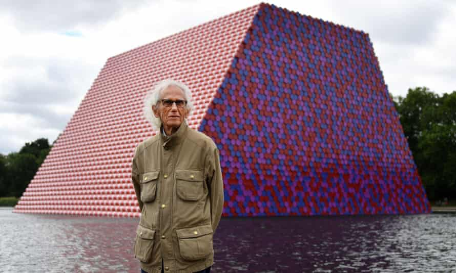The Bulgarian artist Christo in front of his artwork Mastaba, built on the Serpentine in London, June 2018.