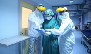 Frontline healthcare workers in Turkey wear protective suits, as infections continued to escalate globally.