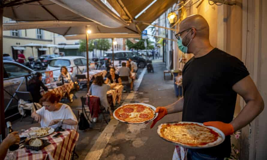 A reopened restaurant in Rome, practising social distancing.