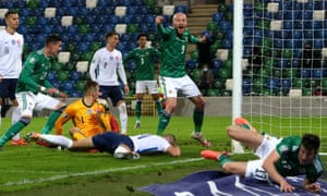 Northern Ireland's Liam Boyce (centre right) celebrates after Slovakia's Milan Skriniar (floor) scores an own goal.