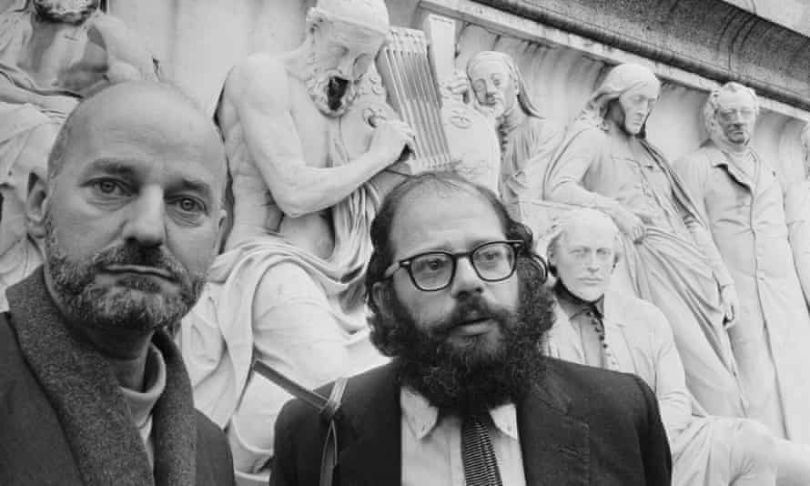 Lawrence Ferlinghetti, left, and Allen Ginsberg at the Albert Memorial, near the Royal Albert Hall, London, where they were taking part in the International Poetry Incarnation, 1965.