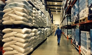 A worker walks in the warehouse of East End Foods in Birmingham, England.