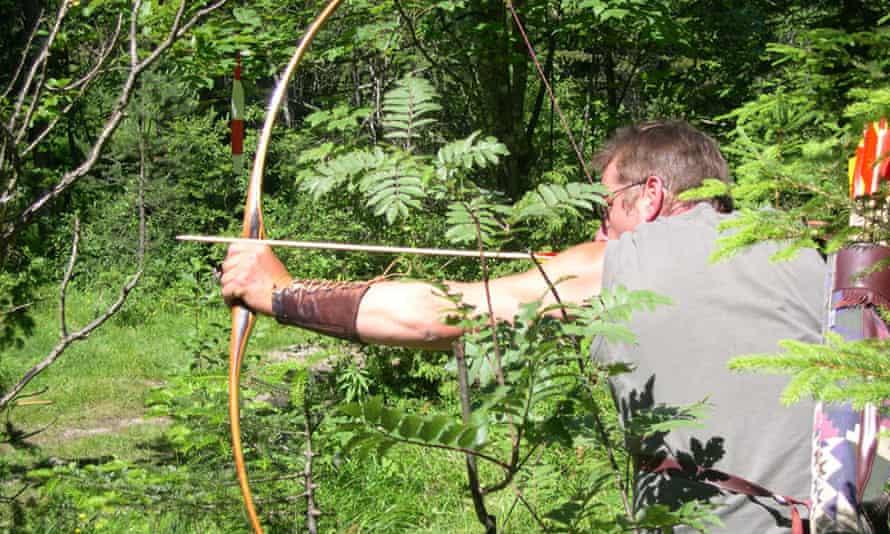 A man with bow and arrow