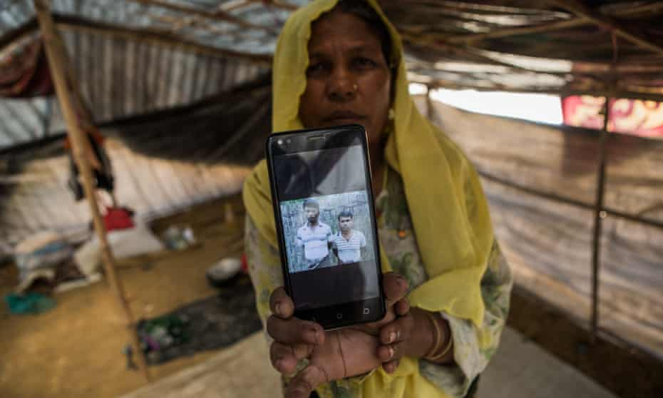 Nur Asha with a photograph of the sons she lost in Myanmar.