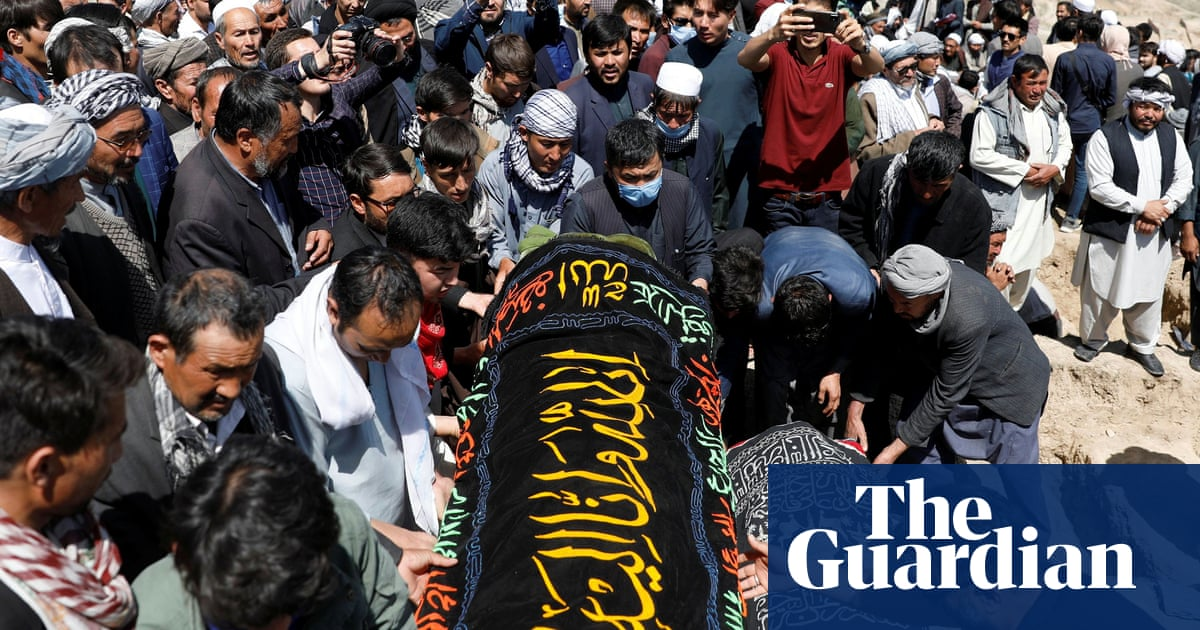 Afghans bury their dead after dozens of girls killed in school blasts