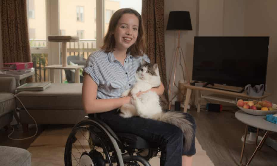 Lucy Stafford, who uses privately prescribed medicinal cannabis to alleviate symptoms of Ehlers-Danlos syndrome, at home in Cambridge.