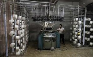 An employee at a textile factory in Aleppo's Kallaseh neighbourhood