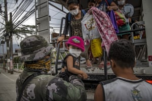 Residents fleeing the eruption arrive at an evacuation centre in Santo Tomas, Batangas province