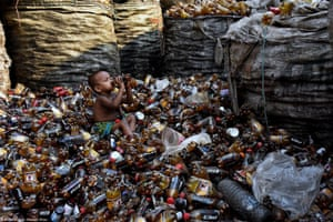 Bangladesh 29. Life - Md Mahabub Hossain Khan - Drinking from Garbage - A little child drinking from a bottle.
