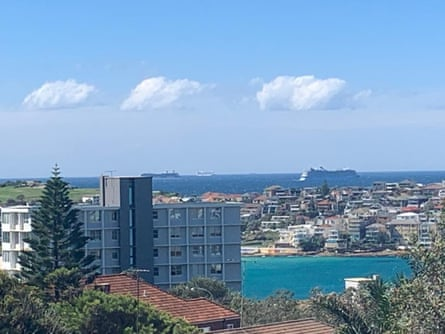 Cruise ships waiting off the heads of Sydney harbour on Saturday.