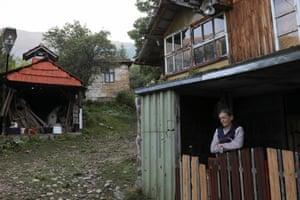 Vida in front of her home