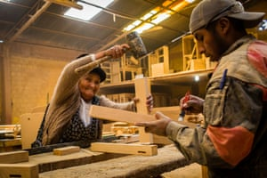 Catalina Tola Silvera fixes furniture in her factory in El Alto
