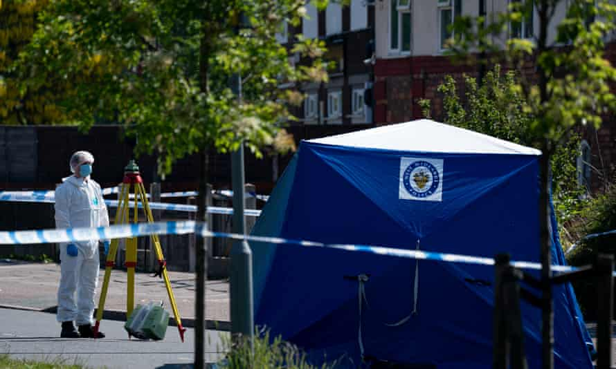 Forensics officer in College Road, Kingstanding, Birmingham, on Tuesday, where a 14-year-old died