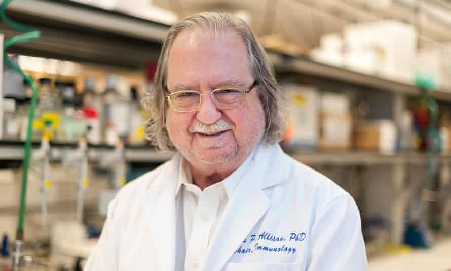jim allison smiling for the camera in a laboratory