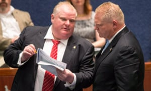 Doug Ford with his brother Rob Ford, left, the late Toronto mayor who was notorious for smoking crack while in office, in November 2013.