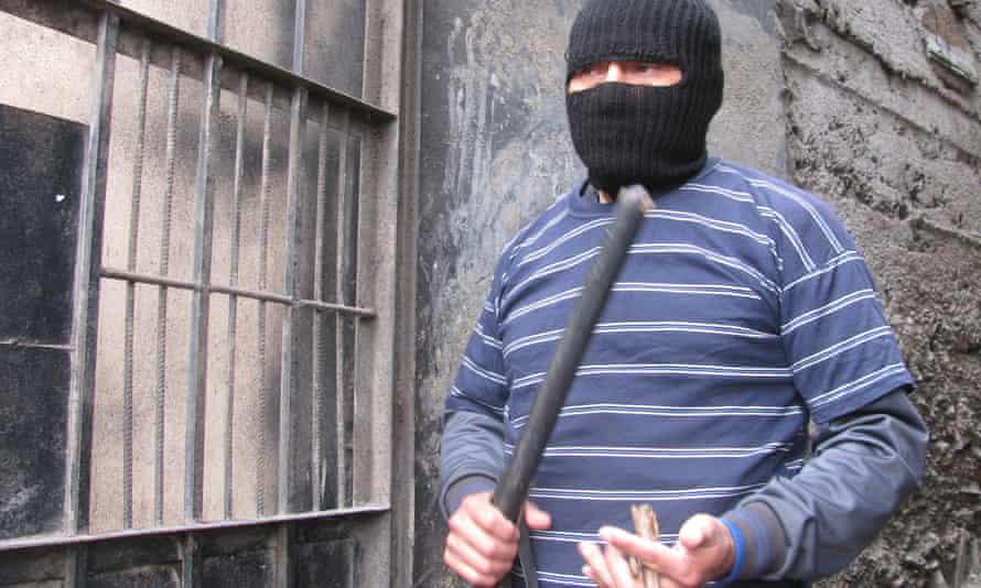 Vigilante leader Holler Vilchez readies himself for a night-time patrol of his neighbourhood.