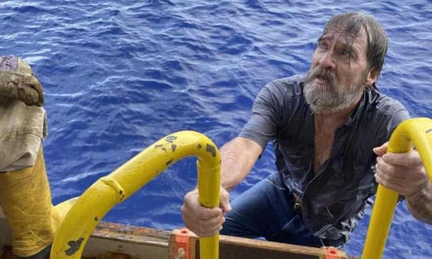 Stuart Bee climbing onto the Angeles cargo ship, off the coast of Florida