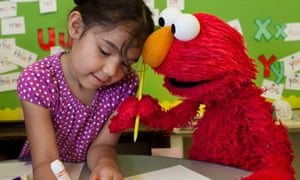 Elmo works with a child.