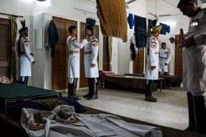 Soldiers prepare their uniforms