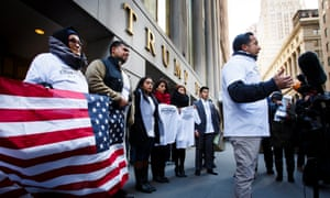 A group of immigrants and attorneys gather outside Trump Tower on 22 November to draw attention to Donald Trump's proposed immigration policies.