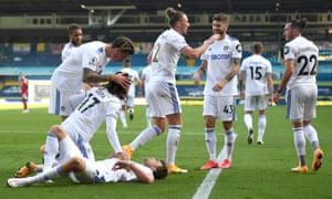 Helder Costa celebrates with teammates after scoring Leeds United's fourth.