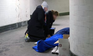 St Mungo's outreach workers talk to a homeless person in London