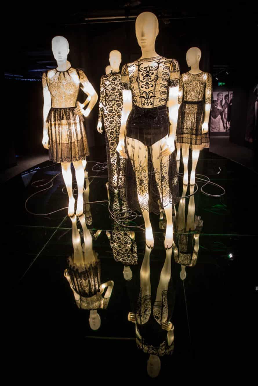 Black-lace dresses on lit-up mannequins, designed by Collette Dinnigan.