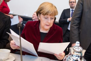 German Chancellor Angela Merkel looks over papers as prior to a meeting of the Christian Democratic Union's (CDU) parliamentary group in Berlin.