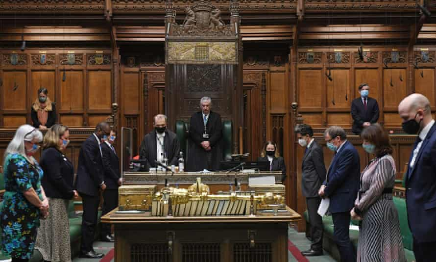 Members of the House of Commons observe the minute's silence